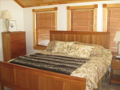 The master suite with a king size bed, personal AC and a tiled private bath.