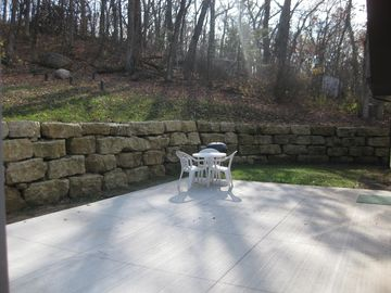 Right outside the back door is a private, wooded spot to enjoy coffee or grill.