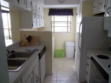 Full service kitchen with pantry and separate laundry area.