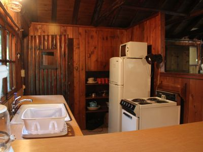 Kitchen- with stove, refrigerator, microwave, coffee maker, dishes, utensils