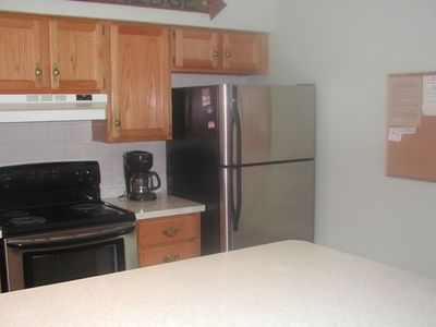 Kitchen has stainless steel appliances.