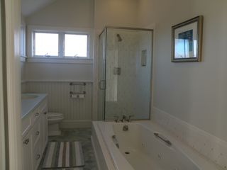 Truro house photo - Master bath with double sink, shower and jacuzzi tub.