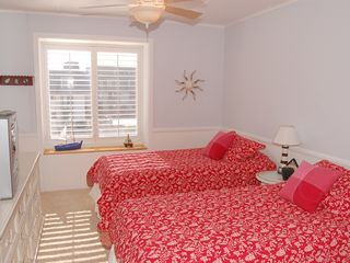 Oceanside condo photo - Guest BR, 2 Twin Beds, Ocean View, Dressers, TV