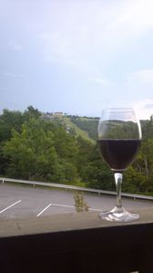 Enjoy a glass of wine on the large balcony that spans the width of the condo.