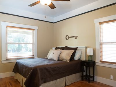 Charming front bedroom has a walk-in closet and queen size bed for your comfort!