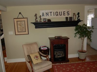 An old style gas fireplace adds to the already cozy ambiance