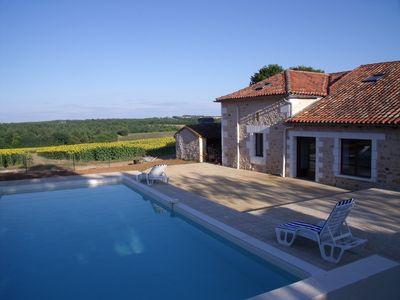 Spacious barn conversion - stunning views,heated pool,terraces seat 12