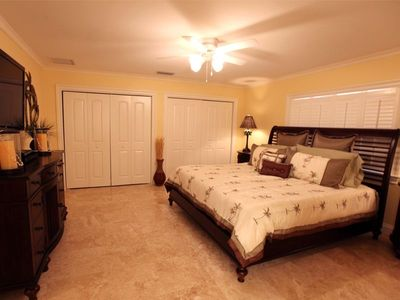 Master Bedroom with king tempurpedic bed and 42in LCD TV with blu-ray
