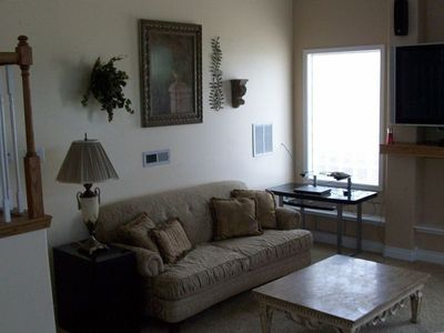 Living area with huge flat screen TV with deluxe satellite package