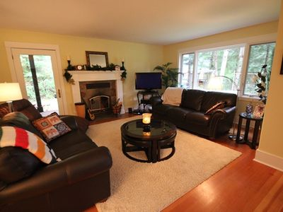 Large traditional living area with television, DVD player and Shaw cable.