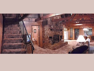 Stairs Go To The Upstairs Loft, Floor-to-Cieling Stone Fireplace In Living Room.