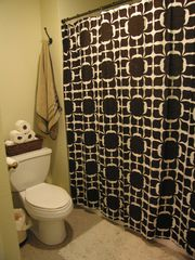 Palm Springs condo photo - Master bath with hand held shower head & tub