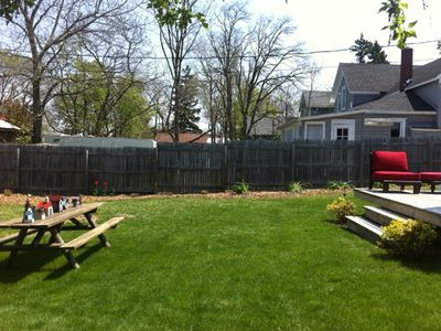 Elk Rapids cottage rental - Grassy portion of gently sloping back yard-perfect for a picnic!