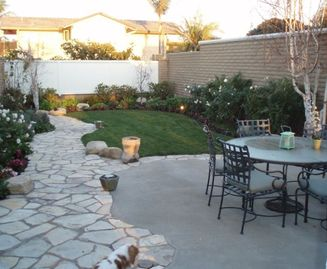 another view of gated yard, patio furniture with bbq