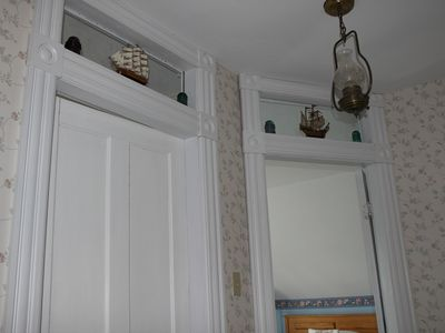 Upstairs bedroom doors - with transom lites to let sun shine into upper hallway.