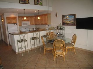 Dining area, with ceiling fan and open floor plan - Lahaina condo vacation rental photo