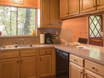 Terrific new kitchen with a mountain view, lots of new cabinets & counter space!