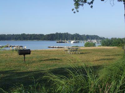 Beach Park w/ BBQ grills & picnic tables. Small beach & protected swim area.