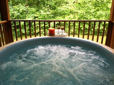 You will love relaxing in the hot tub on the porch!