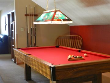 Play pool in the billiard room with views/new felt on pool table.