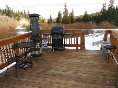 Porch has outdoor seating with a gas grill and a propane heater to keep you warm