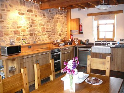 STABLES: Well equipped oak kitchen/dining area