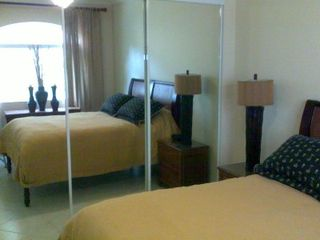 Los Suenos Resort condo photo - Guest bedroom has a double bed and a built in mirrored wardrobe.