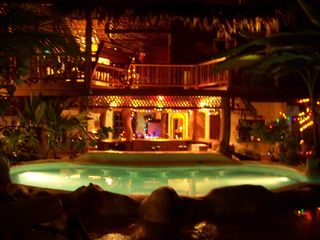 Puerto Viejo bungalow photo - The pool and main house at night