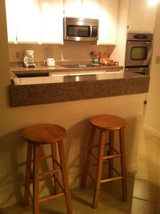 breakfast bar seats two at kitchen counter from dining room side