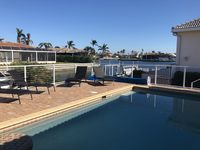 Updated Waterfront Canal  Home with Beach Access Within Walking Distance!
