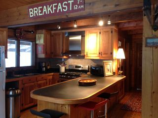 Fully stocked Kitchen with large breakfast bar, stainless hood & gas stove - Kennebunk house vacation rental photo