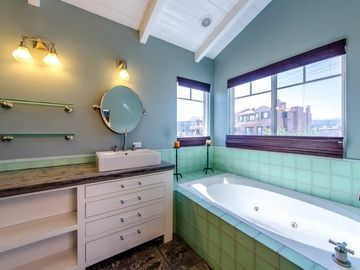 Jetted tub, electronic shades and HIs & Her Sink in Master Bath