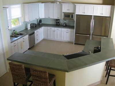 The large gourmet kitchen with island seating.