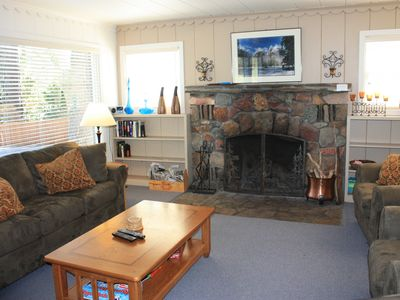 Old Tahoe style living room with wood burning fireplace