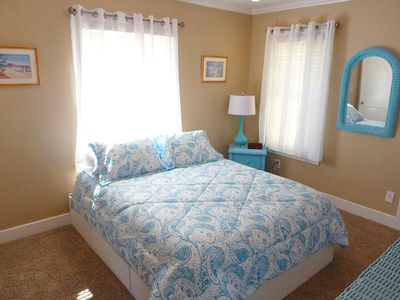 Queen-size bed in bedroom