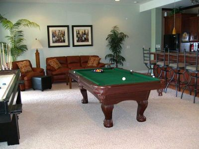 You'll Enjoy Hours of Entertainment in This Game Room with Sit Down Bar.