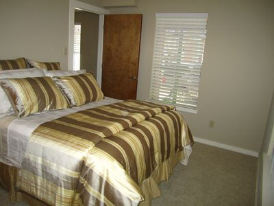 Guest room #2 on 1st floor. Luxurious bedding with high quality queen mattress