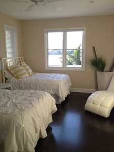 Upstairs bedroom with two full beds and view of the pass from your balcony.