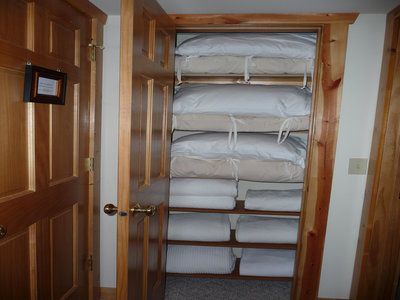 Lower hall closet extra bedding, each & every bed has a down comforter as well