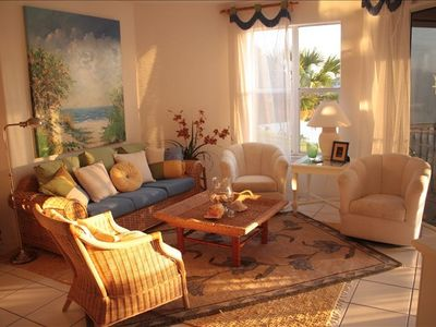 enjoy view through lanai, large screen tv, comfortable furniture in living room