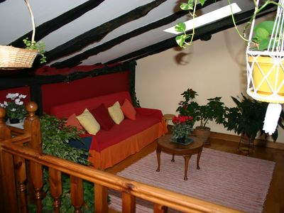 attic room with sofa bed