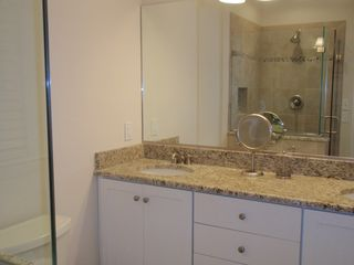 Bethany Beach townhome photo - The recently renovated master bathroom has a tile shower and twin sinks.
