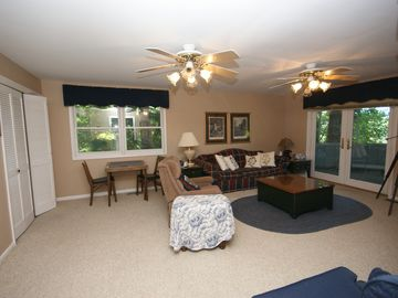 Private Downstairs family rm-washer/dryer and wetbar opens to screened porch.