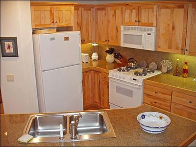 Fully Equipped Kitchen with Wood Cabinets