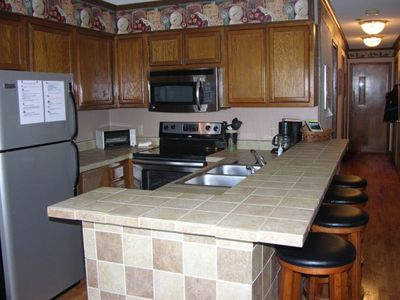 Full kitchen:refrigerator, dishwasher,stove, oven, microwave, coffee maker...