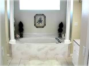 Huge luxury master bath with lg oval tub, walk in shower, 2 lg walk in closets