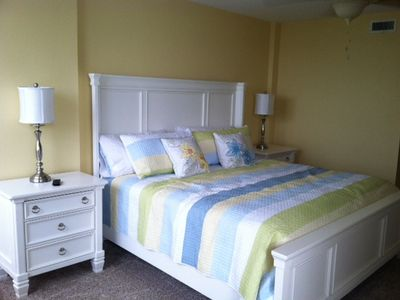 Master bedroom w/ private bath. Windows face intercoastal with access to balcony