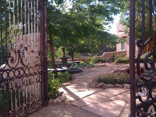 Santa Fe estate photo - Spanish Colonial garden gate leads you into another world...