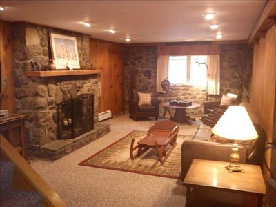 Lower level den has flat screen tv, DVD/VCR, lots of kids movies and board games