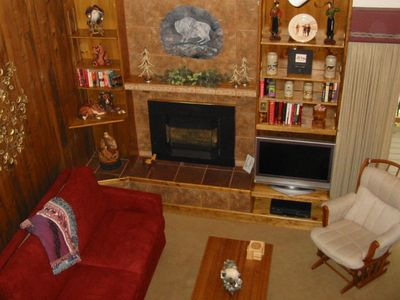 Cozy conversation area features gas fireplace and TV.